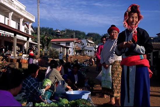 Women in tribal clothes at the Huay Xai market. Laos